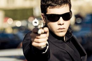 Agent with gun